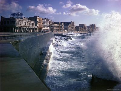 Wave Crashing Against a Breakwater Along the Malecon, a Waterfront Boulevard-Eliot Elisofon-Photographic Print