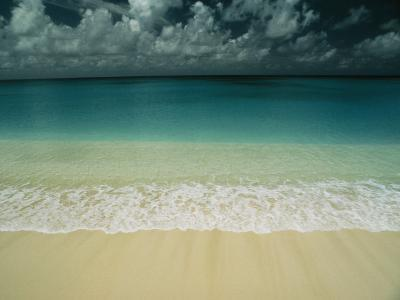 Wave Rolls over a Tranquil Beach in the Marshall Islands-Bill Curtsinger-Photographic Print