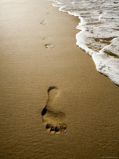 Waves About to Wash over Footprints in the Sand, Anaho Bay, French Polynesia-Tim Laman-Photographic Print