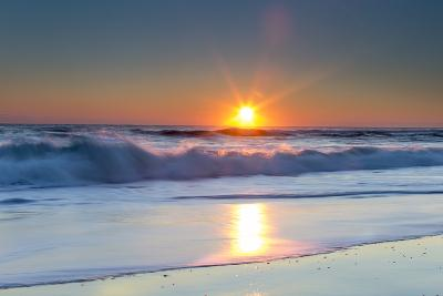 Waves Lap Against the Shore as the Sun Sets-Robbie George-Photographic Print