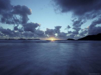 https://imgc.artprintimages.com/img/print/waves-race-ashore-as-the-sun-sets-over-a-remote-and-rugged-coastline-australia_u-l-p2z8380.jpg?p=0