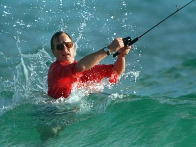 Waves Splash President-Elect George Bush as He Casts a Line While Surf-Fishing--Photographic Print