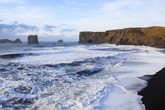 Waves Washing Over Black Beach At The Vik Coastline Looking Toward Dyrholaey. Vik. Iceland-Oscar Dominguez-Photographic Print