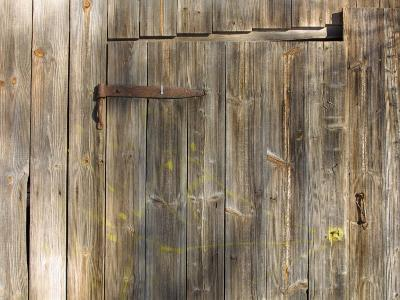 Weathered Wooden Door and Wall with Rusted Brass Hinge--Photographic Print
