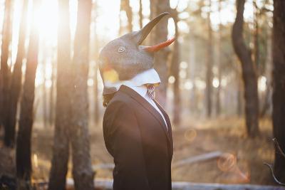 Weird Businessman Wearing a Bird Rubber Mask in the Autumn Sunset Forest- AnastasiaNess-Photographic Print