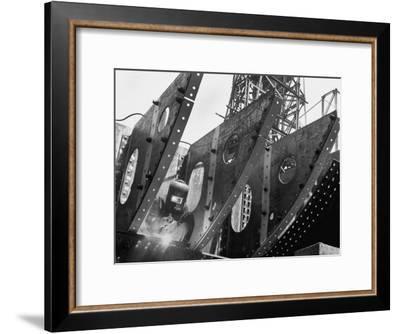 Welder Securing Steel Structure While Working on Hull of a Ship, Bethlehem Shipbuilding Drydock-Margaret Bourke-White-Framed Premium Photographic Print