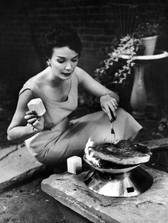 https://imgc.artprintimages.com/img/print/well-dressed-woman-cooking-a-large-steak-on-the-aluminum-disposable-barbecue-grill_u-l-p75l770.jpg?p=0