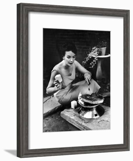 Well-Dressed Woman Cooking a Large Steak on the Aluminum Disposable Barbecue Grill-Peter Stackpole-Framed Premium Photographic Print
