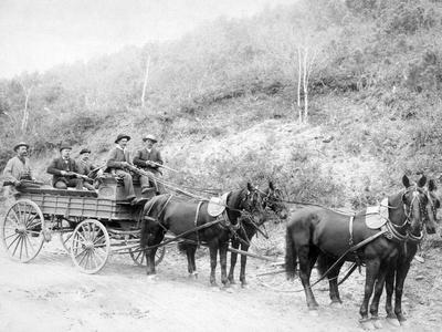 https://imgc.artprintimages.com/img/print/wells-fargo-express-company-wagon-and-guards-carrying-gold-from-mine-photograph-deadwood-sd_u-l-q1go8tk0.jpg?p=0