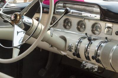 USA, Indiana, Carmel. Steering wheel and dashboard in a classic car.