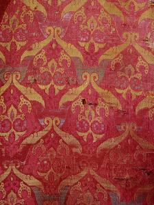 A detail of a red and gold Islamic silk weaving from Granada, Spain, 15th century by Werner Forman