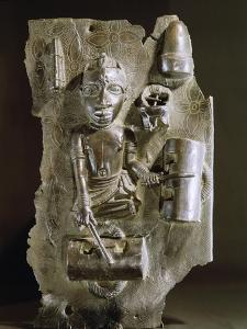 Brass plaque with a representation of a drummer, Benin, Nigeria, probably early 17th century by Werner Forman