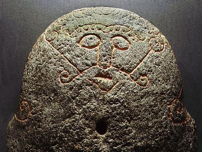 Forge stone incised with the face of Loki, Denmark, Late Viking period