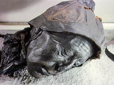 Tollund man, victim of human sacrifice by ritual strangulation, Migration period