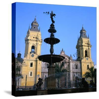 The San Francisco Monastery and Bronze Statue on Plaza De Armas in Lima, Peru
