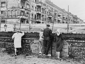 West Berliners Peer over the Infamous Berlin Wall in 1962