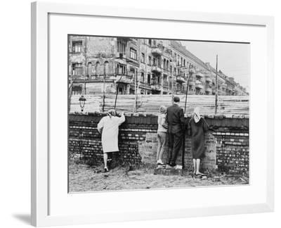 West Berliners Peer over the Infamous Berlin Wall in 1962--Framed Photo
