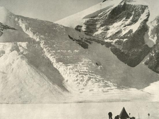 'Western Party's camp on December 28 below a hanging glacier at the Cathedral rocks', 1909-Unknown-Photographic Print