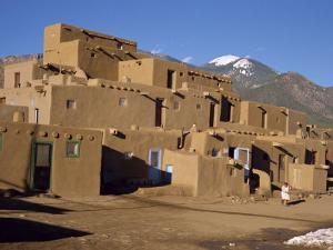 Woman Sweeping Up, in Front of the Adobe Buildings, Dating from 1450, Taos Pueblo, New Mexico, USA by Westwater Nedra