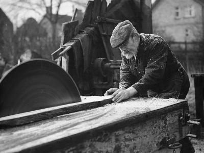 Wheelwright Working with a Circular Saw, February 1935--Photographic Print