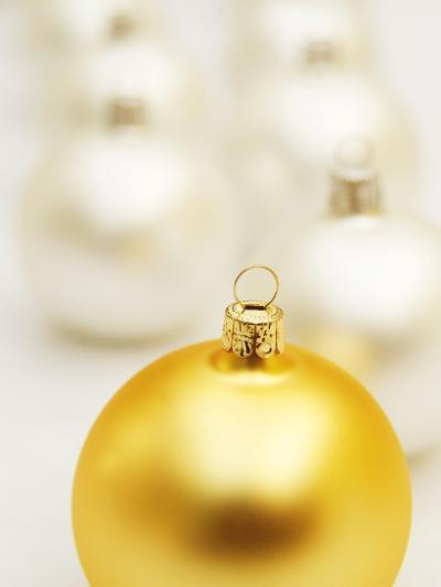 White Christmas tree decorations and a yellow one--Photographic Print