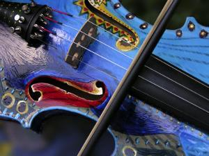 Bow Draws a Melody from the Strings of a Colorful, Painted Violin by White & Petteway