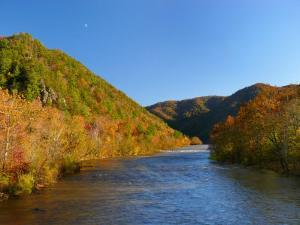 Fall Foliage Glows in the Afternoon Light over the French Broad River by White & Petteway