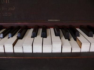 Keys on an Old Piano Show their Age as their Action Has Deteriorated