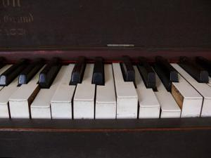 Keys on an Old Piano Show their Age as their Action Has Deteriorated by White & Petteway