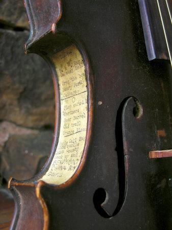 Old Time Song Titles are Pasted onto the Side of an Antique Fiddle