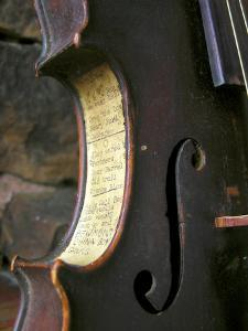 Old Time Song Titles are Pasted onto the Side of an Antique Fiddle by White & Petteway