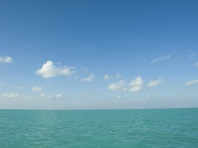 White Puffy Clouds above Turquoise Blue Caribbean Water, Ambergris Caye, Belize-James Forte-Photographic Print