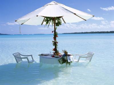 White Table, Chairs and Parasol in the Ocean, Bora Bora (Borabora), Society Islands-Mark Mawson-Photographic Print