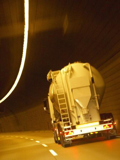 White Tanker Truck Driving Through Tunnel Lit with Electrical Lighting--Photographic Print
