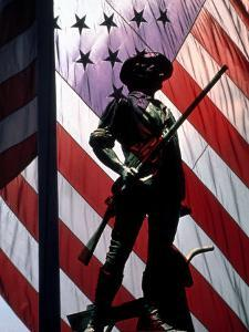 US Flag with Silhouetted Statue of Soldier by Whitney & Irma Sevin
