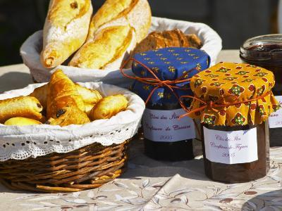 Wicker Basket with Croissants and Breads, Clos Des Iles, Le Brusc, Var, Cote d'Azur, France-Per Karlsson-Photographic Print