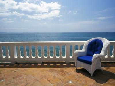 Wicker Chair and Tiled Terrace at the Hornet Dorset Primavera Hotel, Puerto Rico-Michele Molinari-Photographic Print