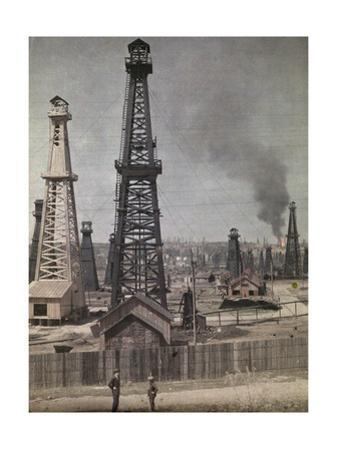 Two Men Stand Outside Oil Region at Foot of Carpathian Mountains by Wilhelm Tobien