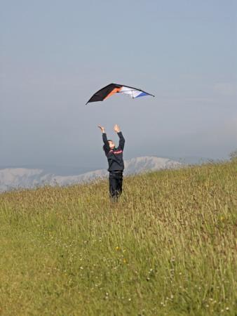 England, Isle of Wight; Boy Flying a Kite on the Downs Near Compton Bay in Southwest of the Island