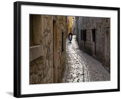 Scooter Riding Down Cobbled Backstreet