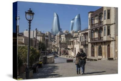 A Couple Strolls Through Baku's Old City under the Modern Flame Towers