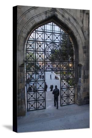 A Pedestrian Walks Through the Old City Gate in Baku