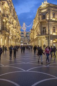 Pedestrians Stroll Through Baku's Shopping District by Will Van Overbeek
