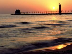 Sunset Light on Grand Haven Lighthouse, MI by Willard Clay