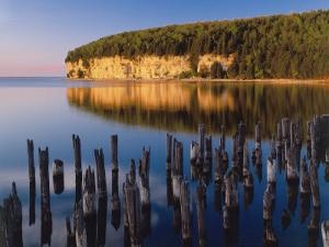 Sunset Light on the Cliffs on Big Bay De Noc at Fayette State Historic Park, Michigan, USA by Willard Clay