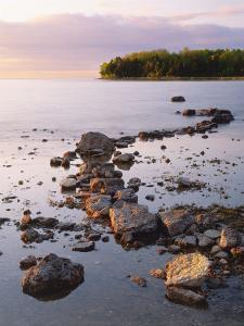 Sunset Light on the Rocky Shore of Green Bay at Peninsula State Park, Wisconsin, USA by Willard Clay