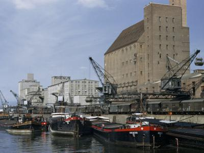Cargo Barges from Rotterdam Line Riverside Wharf Beside Warehouses by Willard Culver