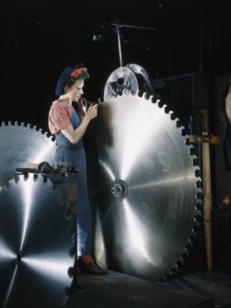 Factory Worker Inspects Notches of a Large Steel Saw Blade by Willard Culver