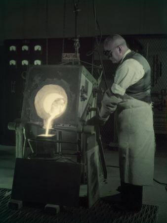Man Pours New Metal Alloy from Furnace to Mold for Telephone Magnets by Willard Culver