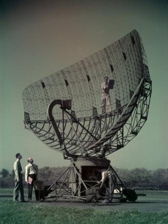 Men Look at Radar with Hook-Shaped Wave Guide by Willard Culver